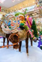Christmas Elf riding reindeer
