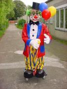 Clown mit Luftballons und Spazierstock