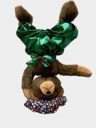 Teddy bear turns on his head