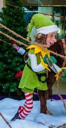 Christmas Elf with rope over his shoulder