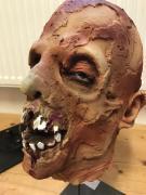 Head with skin shreds