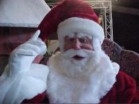 Speaking Santa Claus sitting in the easy chair