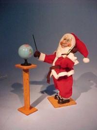 Weihnachtsmann mit Globus