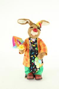 Hare's clown with screen, flower and eggs in the Hand