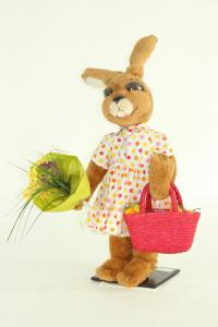 Hare- woman with bouquet and carrier bag