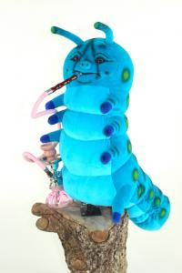Caterpillar with water pipe from the fairytale Alice in Wonderland