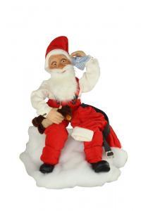 Weihnachtsmann auf Hocker mit Teddy im Arm