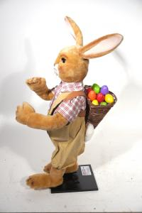 rabbit with basket on his back with Easter eggs