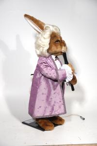 Hare- musician in the baroque garment with flute