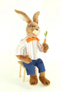 Hare- seated with carrot in the hand