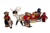 Teddy bears load a sled