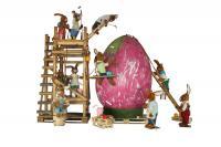 8 Hasen bemalen ein großes Ei