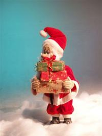 Santa stacking wrapped gifts